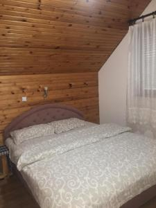 A bed or beds in a room at Apartments Andela