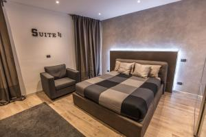 Ένα ή περισσότερα κρεβάτια σε δωμάτιο στο SUITE 11 NEAR DUOMO