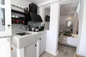 A kitchen or kitchenette at Annio Studios