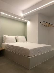 A bed or beds in a room at Drimoni Boutique