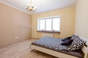 Ein Bett oder Betten in einem Zimmer der Unterkunft Beauté de Varsovie