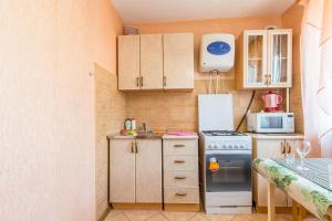 Una cocina o zona de cocina en Apartments in the center of Minsk on international st
