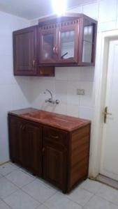 O bucătărie sau chicinetă la Al Khalile Apartment