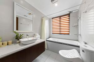 A bathroom at Newsky Serviced Apartment