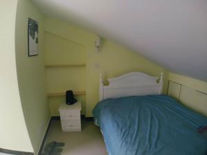 Ein Bett oder Betten in einem Zimmer der Unterkunft Apartment near Disney/Zhangjiang/Pudong Airport