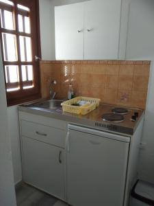 A kitchen or kitchenette at Nikoletta Studios