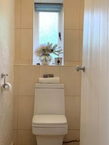 A bathroom at Four-Bedroom Cottage
