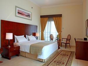Uma cama ou camas num quarto em Rose Garden Hotel Apartments - Barsha