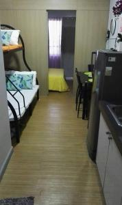 A bunk bed or bunk beds in a room at marcelin's Place Tower 2 at Grace Resindeces Taguig
