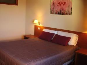 A bed or beds in a room at Departamentos Altos del Centro