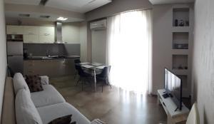 A kitchen or kitchenette at Apartment on Rustaveli