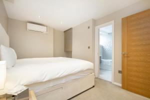 A bed or beds in a room at Crawford Suites Serviced Apartments