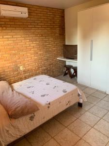 A bed or beds in a room at Casa na Praia de Sauaçuhy - Ipioca - Maceió - AL