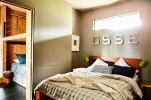 A bed or beds in a room at Riversdale Retreat