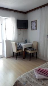 A television and/or entertainment center at Apartments Marina