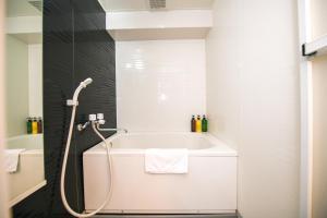 A bathroom at Dotonbori Apartment Next JR Namba