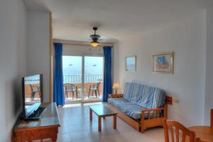 A seating area at Aparthotel La Mirage
