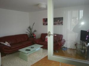 Ein Sitzbereich in der Unterkunft Gimmco Appartements