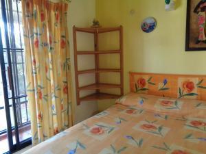 Ein Bett oder Betten in einem Zimmer der Unterkunft Residencial Las Tejas