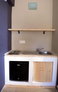 A kitchen or kitchenette at Lefka Hotel & Apartments