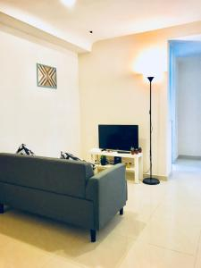 A television and/or entertainment center at Convenient 4BR Flat In Mong Kok!