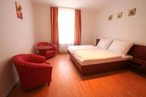Ліжко або ліжка в номері Apart Hotel Susa