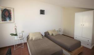 Letto o letti in una camera di Appartamenti Sole 1