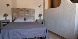 Un ou plusieurs lits dans un hébergement de l'établissement La Maison des Hautures