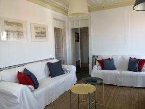 A seating area at Alfama Tejo charming apartment