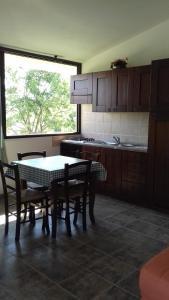 A kitchen or kitchenette at Case Vacanze Corongiu