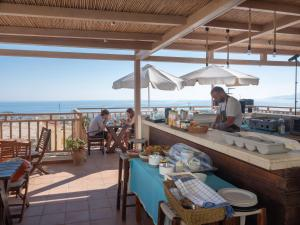 A restaurant or other place to eat at Kalimera Village Piskopiano