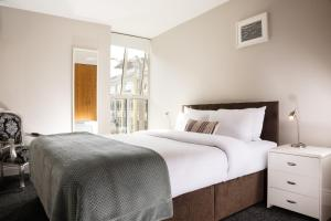 A bed or beds in a room at Jervis Apartments Dublin City