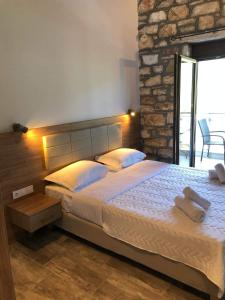 A bed or beds in a room at Dioscuri Luxury Apartments