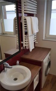 Koupelna v ubytování Apartament Zamkowy