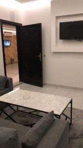 A television and/or entertainment center at Rahat Al Hawiyah Apartments 1