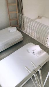Ένα ή περισσότερα κρεβάτια σε δωμάτιο στο Aristotelia Gi