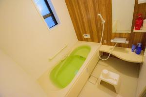 A bathroom at Spacious & Modern Inn Megumi-an Nishijin