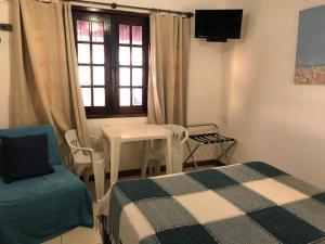 Telewizja i/lub zestaw kina domowego w obiekcie Cesar Apartamentos