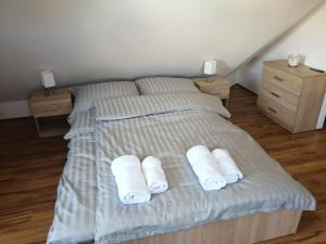 A bed or beds in a room at Bárka's Apartman