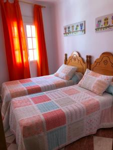 A bed or beds in a room at Casas Vistas Pantano