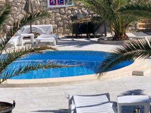 The swimming pool at or near Apartments Roxsi