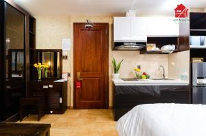 A kitchen or kitchenette at An Nhien - Nguyen Trai Service Apartment