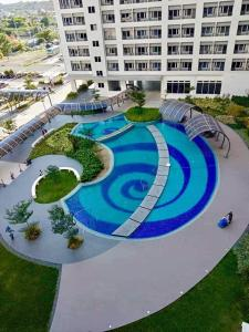 A view of the pool at marcelin's Place Tower 2 at Grace Resindeces Taguig or nearby