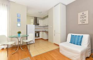 A kitchen or kitchenette at Central Passage Budapest Apartments