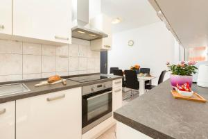A kitchen or kitchenette at Marasovica Apartments