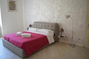 Letto o letti in una camera di Allegra Toscana