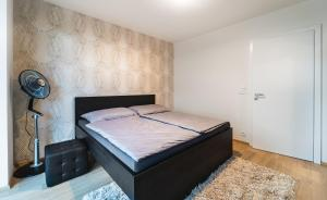 A bed or beds in a room at In Apartments