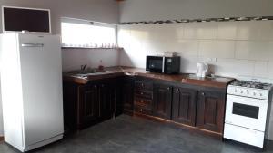 Una cocina o kitchenette en Los Benteveos