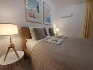 Cama o camas de una habitación en Villa La Palmerale Puerto de la Duquesa