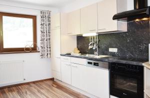 Küche/Küchenzeile in der Unterkunft Appartments Enterwald